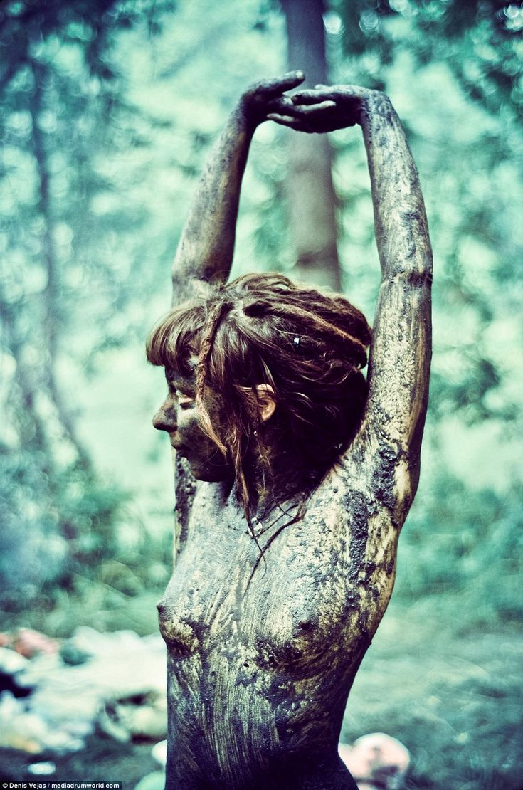 A young woman covered in mud at a Rainbow Gathering event, which promote freedom and uncon...