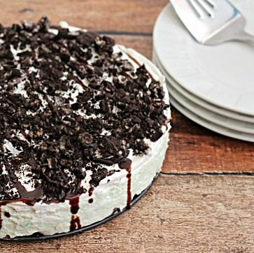No Bake Mint Oreo Cheesecake ~ Oreo crust piled with light and fluffy cheesecake flavored with mint and topped with crushed Oreos and chocol...