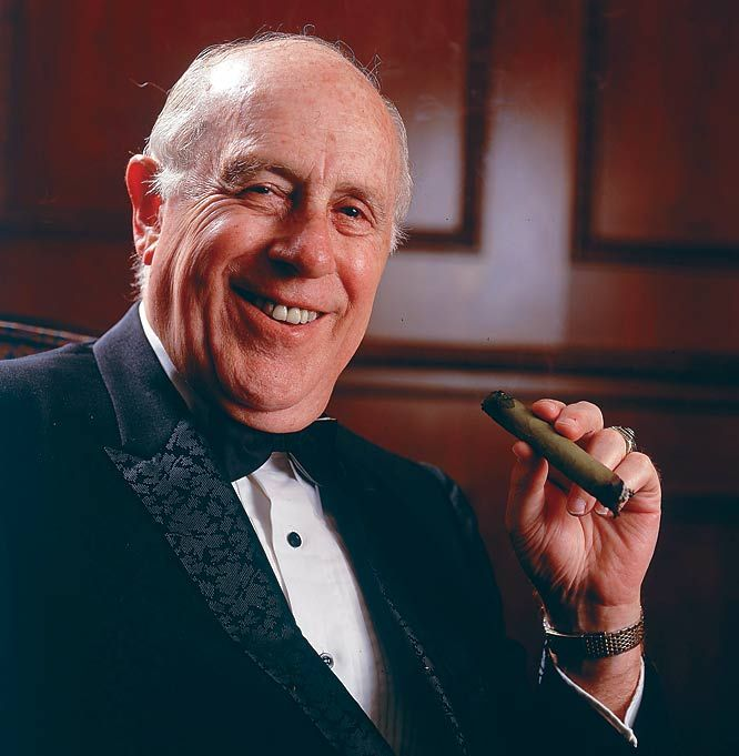 Celtics patriarch Red Auerbach enjoys a cigar during this 1992 photo shoot.