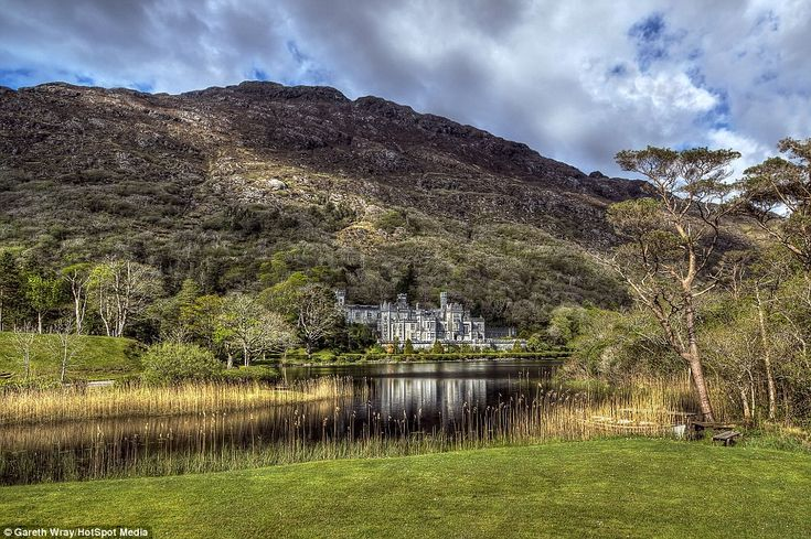 The stunning Keylemore Abbey in Connemara, County Galway, looks as though it's being overrun by its surroundings