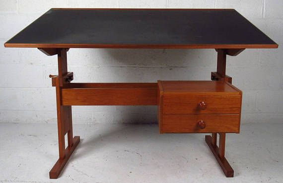Amazing Danish modern drafting desk from the 1970s. Drawer unit can be adjusted to either side of the desk. Desk is teak with black top. This is in excellent condition, very solid and sturdy. **************************************************** Please note that buyer pays for shipping on this item. We are happy to help arrange shipping or make regional referrals if needed. Local Maryland delivery or pick up is available. Email info [!at] modandozzie.com or text 443-474-0058 if you have qu...