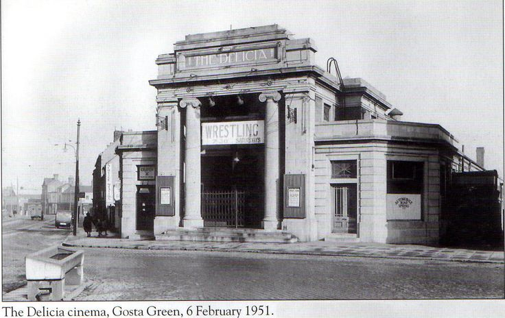 The Delicia cinema, Gosta Green, on Feb 6th 1951, shot during the same period that the Main Building was under construction. The cinema opened on November 5, 1923 and closed in 1944. It later became a venue for wrestling (as shown on the banner in this photo) and then became home to the #BBC Midlands television studios, before they relocated to Pebble Mill. Aston University purchased the building in 1971 and today (2013) it houses the European Bioenergy Research Institute (EBRI).