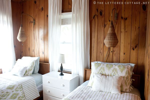 Wood paneling & white curtains. Very airy... but her paneling might be darker.