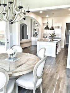 Kitchen Breakfast Room... I always prefer round tables over rectangular. This one is from Nebraska Furniture Mart.  Kitchen nook chairs: Restoration Hardware Vintage French round chair; wood stain: weathered oak drifted; chair fabric: Belgium linen in sand.