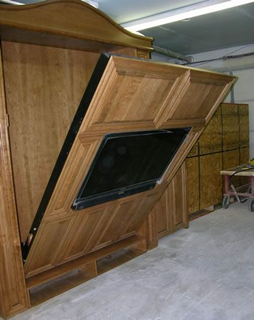 Murphy Bed with tv. Maybe this combines 2 things that should stay separate, but it's cool!