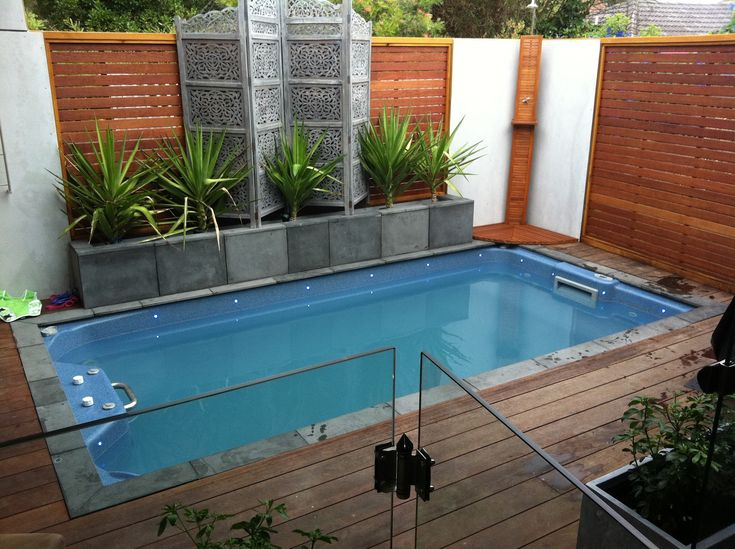 Pools For Small Backyards Design Ideas, Pictures, Remodel, and Decor - page 30 Nice jacuzzi, bamboo for privacy, is it cheaper to build deck to house an above ground unit or install an in-ground pool? Description from pinterest.com. I searched for this on bing.com/images