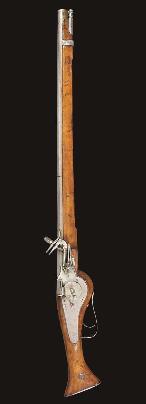 A GERMAN LONG WHEEL-LOCK CUIRASSIER PISTOL -  CIRCA 1620-30