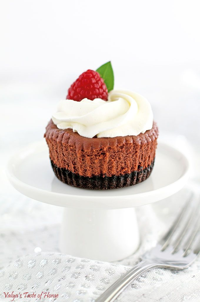 These Oreo Chocolate Mini Cheesecakes have a scrumptious Oreo cookie crust, a creamy chocolate cheesecake filling, topped with tasty soft cream and garnished with your favorite berries (raspberries pairs best for me) that makes them a crowd favorite dessert. These are very well enjoyed at any gathering and serve as party table decor and are absolutely loved by chocolate lovers. | www.valyastasteofhome.com