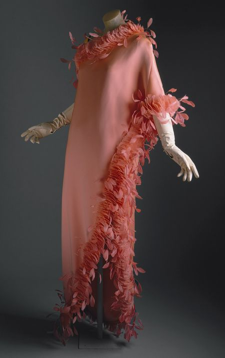 Evening gown, circa 1968, by Hubert de Givenchy (French, born 1927). Salmon-colored silk with feathers.