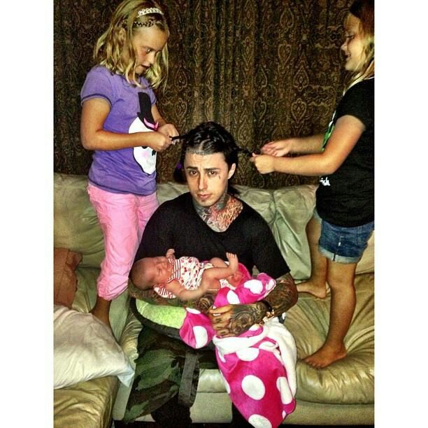 Ronnie with his baby and having his hair braided <3