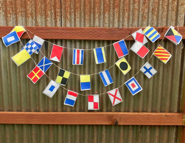 Nautical flags garland, A-Z, Small flags by NoelleODesigns on Etsy https://www.etsy.com/listing/266763539/nautical-flags-garland-a-z-small-flags