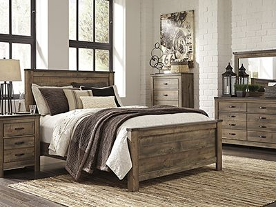 Trinell 5-pc. Queen Bedroom Set - Replicated oak grain takes the look of rustic reclaimed wood on this queen panel bed. The modern farmhouse style is at home in the master or guest bedroom. #steinhafels