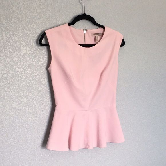 """PINK PEPLUM TOP Pink woven peplum top from Love 21 by Forever 21. Round neckline.Sleeveless.Darted waist.Zipper placket in back. Measures approx. 23"""" length. Shell:66%polyester 39%rayon 4%spandex/elastane. Condition: gently used, very light stains/discoloration around arm hole areas-just needs cleaning (tried my best to capture, see last two images). Sold AS IS. Final Sale.  ❌NO TRADES ❌No Offsite Transactions  ✅All Price Negotiations are handled strictly through the OFFER Feature only…"""