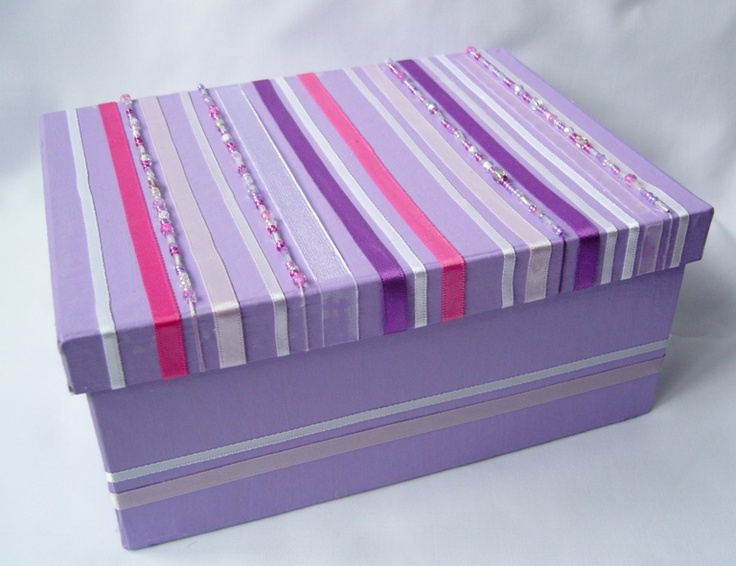 Paint or cover a shoe box...decorate with ribbons...