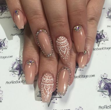These movie star nails created by nail tech Nicole are truly showstoppers. We love the nude base color accented with crystals and delicate lacy henna. Lovely for a bride too!