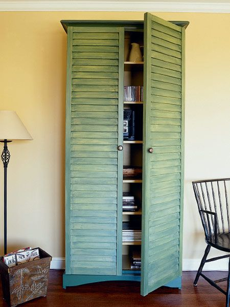This tall cabinet adds storage and a casual country look to any room. The surprise is that it's so easy to make: You start with an unfinished bookcase--whatever size suits your purpose--and add a pair of ready-made louvered shutters. For this 7-foot-tall cabinet, 18-by-80 7/8-inch shutters were used. Shutters typically come in two styles: traditional, with 1 1/4-inch slats, and plantation, with 2 1/4-inch slats. The latter were selected because their scale fit this large unit. (Photo: Thomas…
