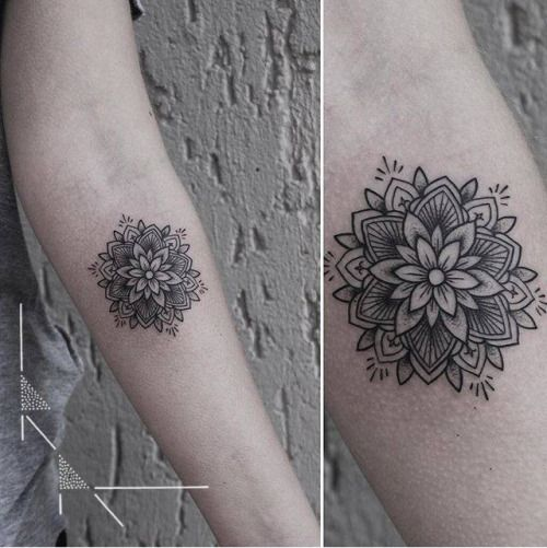 Mandala tattoo on the left inner forearm. Tattoo artist:...