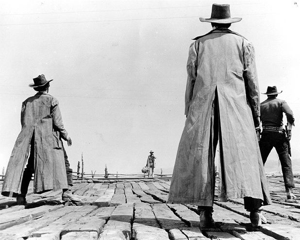 Once upon a time in the west, director Sergio Leone. Amazing opening scene. Great film.