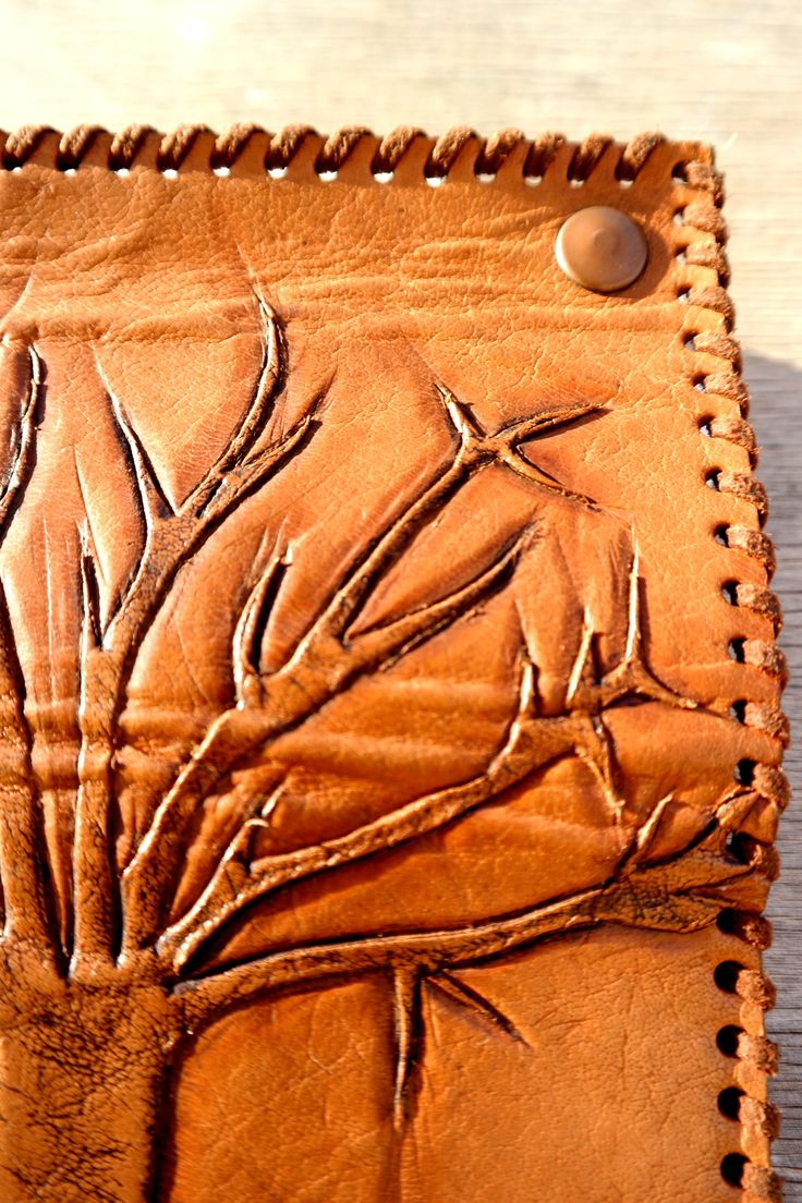 tree engrave on leather tobacco bag