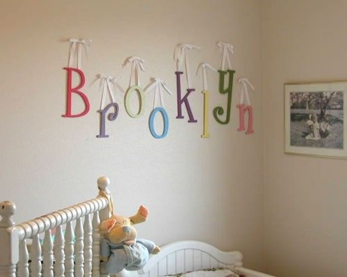 Letters To Hang On Wall hang painted wooden letters with ribbon to spell baby's name. | if