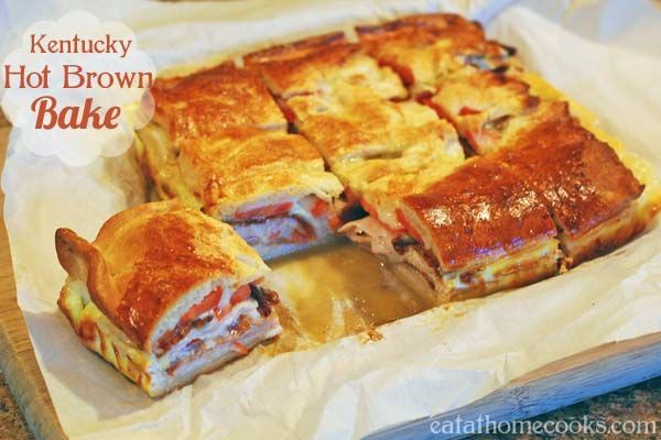 Kentucky Hot Brown Bake layered with turkey, bacon, cheese, tomatoes and baked on crescent roll dough. Best sandwich ever!