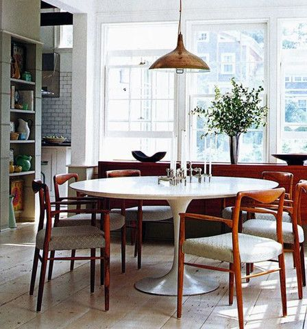 white round tulip table with mid century modern wood chairs for kitchen ((one day))