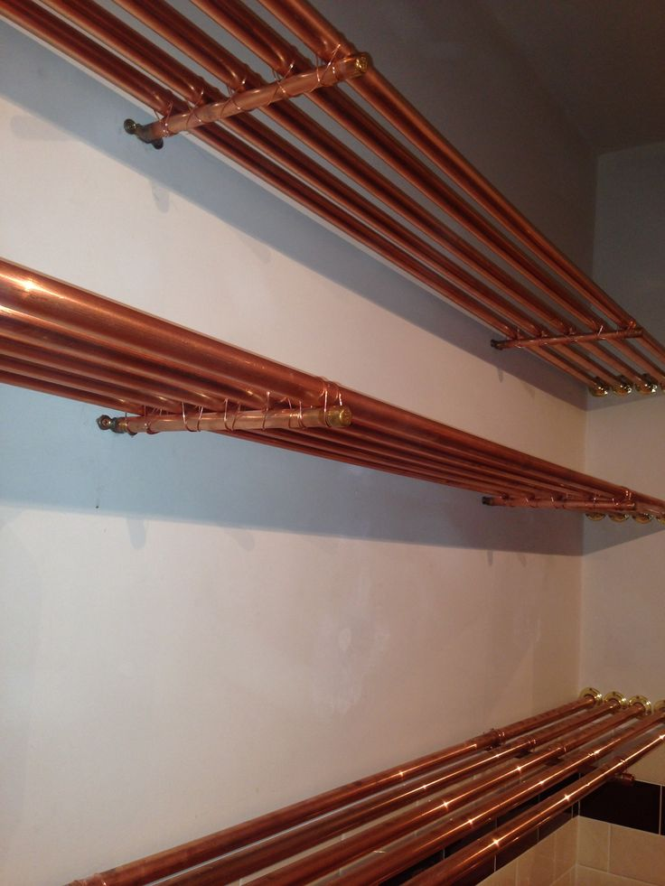 Hand cut customised copper pipe shelving for our back bar area. #Design  #interiordesign
