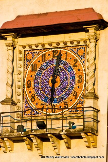Big, colorful wall clock on Paderewskiego Street,  Poznan, Poland