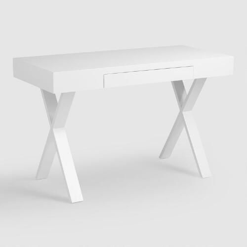 """The crisp lines and ample tabletop of our Josephine Desk make it one of our favorite stylish spots to sit and get things done. In bright, high-gloss white with """"X""""-shaped legs, and complete with a handy keyboard tray, it combines pretty with practical for a show-stopping look that's thoroughly functional."""