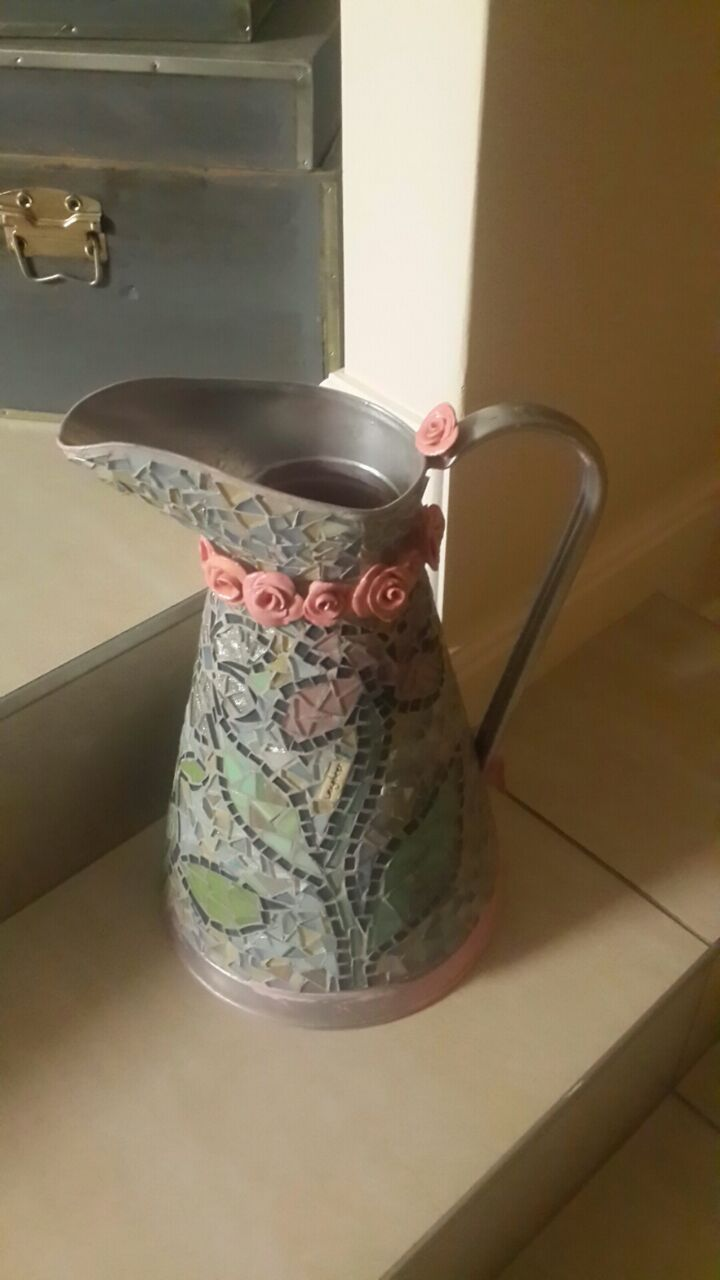 mosaiced watering can