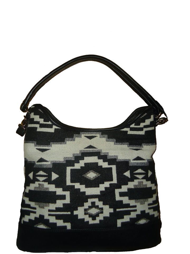 Showcasing a beautiful design, this printed bag from Refashion makes for an instant steal this season. This women's bag is not only spacious, but is lightweight and long-lasting too, Crafted from leather and fabric