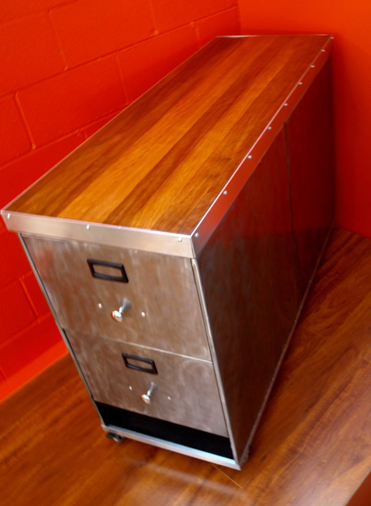 Stunning Polished steel  Retro Industrial Island Bench with two deep drawers each end. This has been mounted on industrial castors and is an ideal addition for the Kitchen.