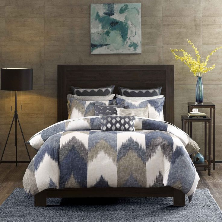 Spice up your bedroom with the INK+IVY Alpine Collection. Rich shades of navy and taupe play up this broken chevron motif for a casual update to your bedroom.