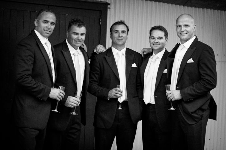 Groom and groomsmen at a wedding at home at Milford beach, Auckland. Black and White.  beguiling fine art family photographs for the walls of the most discerning clients homes. We specialise in wedding and family portrait photography, and supply prints on the highest quality media, framed in beautiful conservation standard frames. We are a high end studio located in the beautiful city of Auckland, New Zealand.