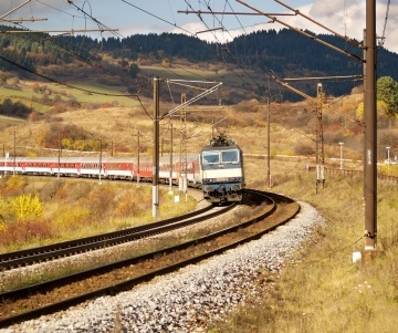 Autumn view of fast train and railroad in Liptov region, Slovakia.