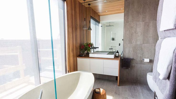 Kyal + Kara's main bathroom | The Block Fans v Faves. - warm and inviting combination of grey, white and wood