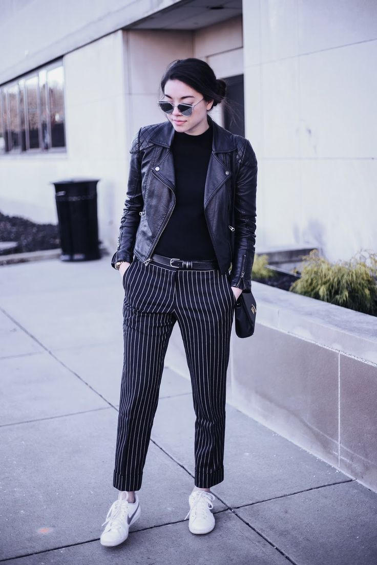 Emma's Style Guide: Pinstripe. Black top+black pinstripe pants+white sneakers+black moto leather jacket+black belt+black shoulder bag+sunglasses. Spring Casual Outfit 2017