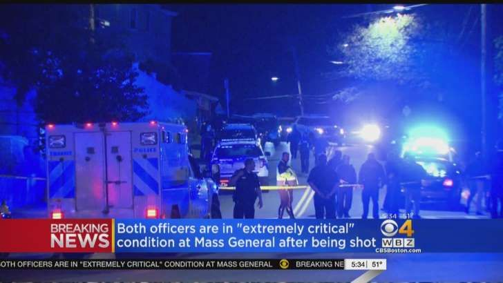 Boston police shot and killed a man wearing body armor and wielding an assault rifle who critically injured two officers responding to a domestic disturbance call late Wednesday, according to Police Commissioner William Evans.