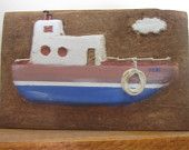 Miniature wooden boat carving (5.5' width, 3.5' height)