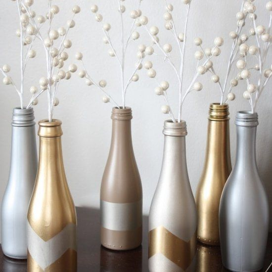 Create a clean, simple decor look by recycling small champagne bottles. Recycling never looked so chic.