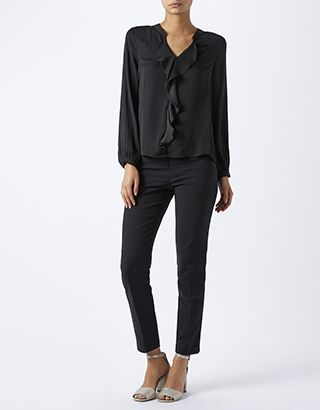 With waterfall frills down the centre for a fluid and feminine effect, our Jenny blouse lends an air of romance to smart outfits. Featuring long sleeves and ...