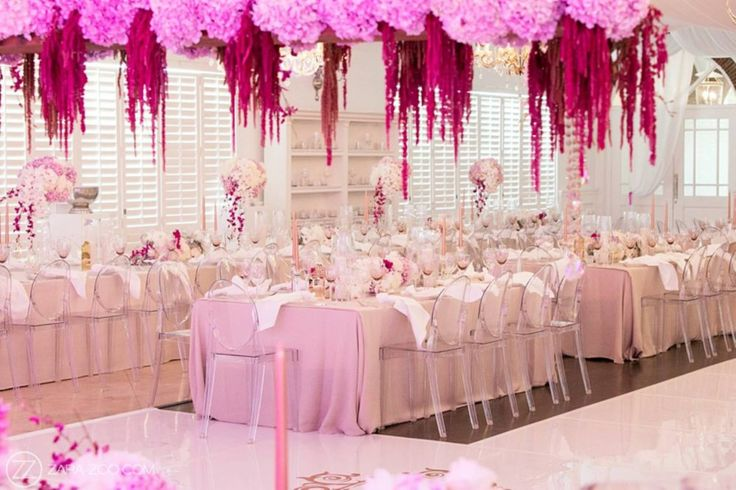 Shari & Tendai Wedding | 15 January 2017 | The Aleit Group  Magenta flowers. Wedding reception. Pink lighting. Flower ceiling. Table setting. Polo Estate Wedding. Zara - Zoo Photography. Val de Vie Estate, South Africa.
