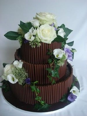 Chocolate wedding cake with some great textural details; a bit too floral but I like it