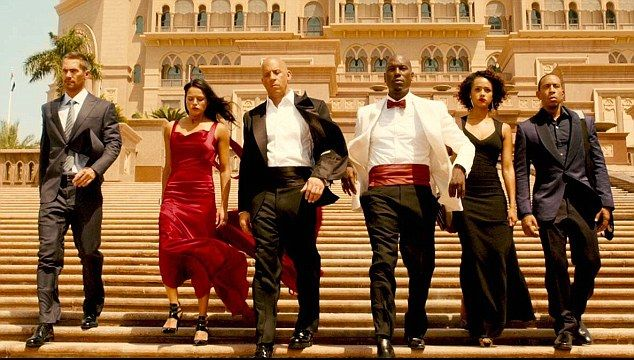 Getting the gang together: The late Paul Walker, pictured left, was part of a starry cast that includesMichelle Rodriguez, Vin Diesel,Jordana Brewster, Tyrese Gibson and Dwayne Johnson (not shown)