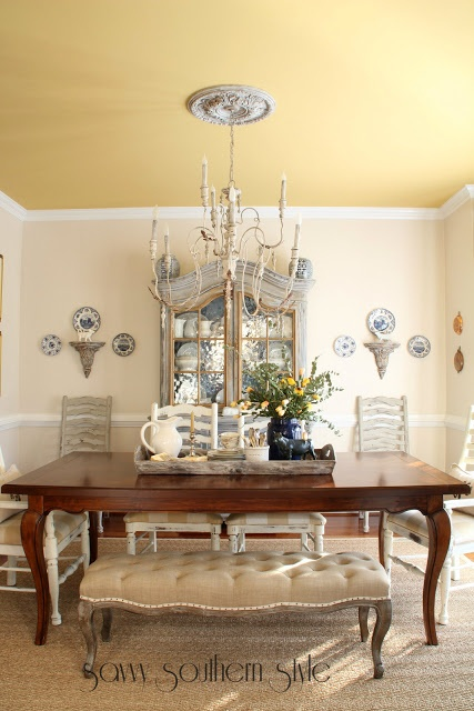 Dining room: Swiss coffee by Behr on walls.  Ceiling is York Harbor Yellow by Benjamin Moore