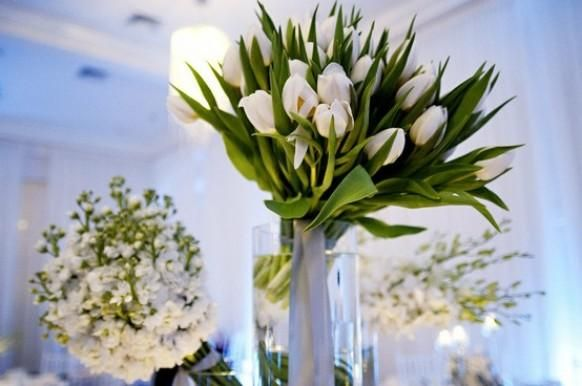 Weddbook is a content discovery engine mostly specialized on wedding concept. You can collect images, videos or articles you discovered  organize them, add your own ideas to your collections and share with other people | Bunches and bunches of all white flowers - in this case tulips - for this stunning @Belle Mer wedding reception.