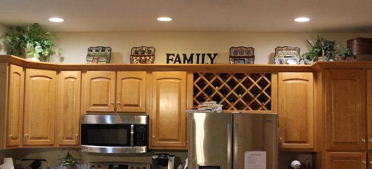 decorating above the kitchen cabinets i put suitcases in the corner