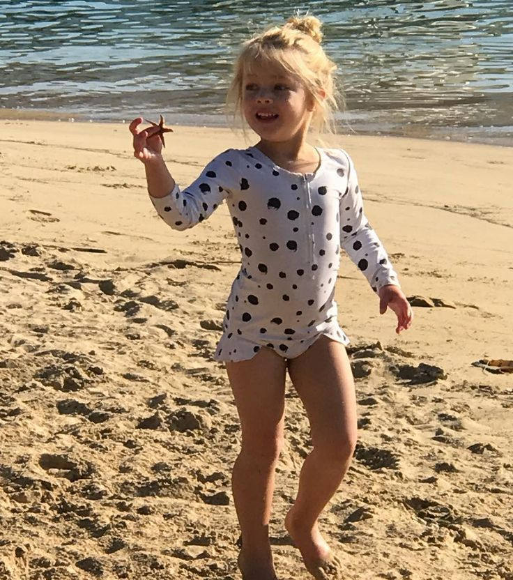 FREE SHIPPING OVER $60! Hand designed #kidswear , these black and white swimmers with hand-designed dalmation illustrations are perfect for running around the beach in summer. Swimwear for the funky baby, kid or toddler!