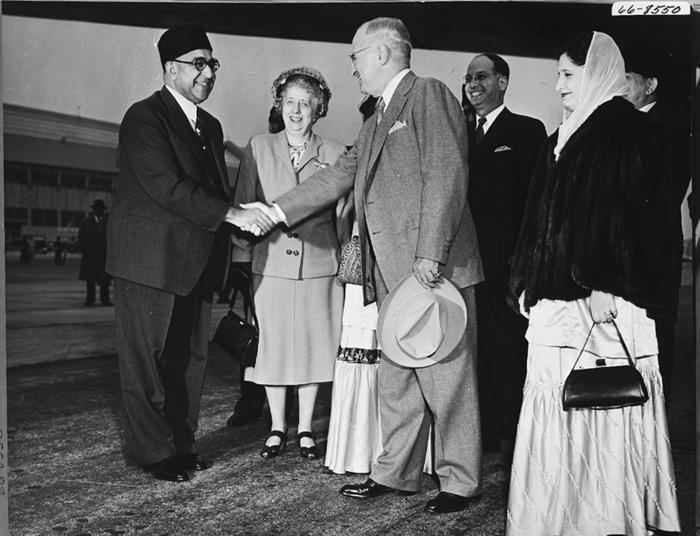 President Harry Truman greets Prime Minister Liaquat Ali Khan of Pakistan upon his arrival at Washington National Airport in Arlington, VA. From left are Prime Minister Ali Khan, First Lady Bess Truman, President Harry Truman, an unidentified man and an unidentified member of Ali Khan's party, May 3, 1950.