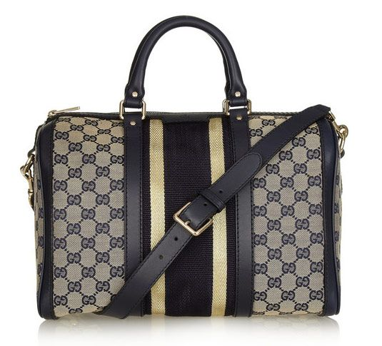 This is definitely an eye catcher!! -Gucci Striped Boston Bag, $1095 via Net-a-Porter